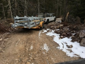 Delivering steel bridge pieces to the Nine Mile River crossing